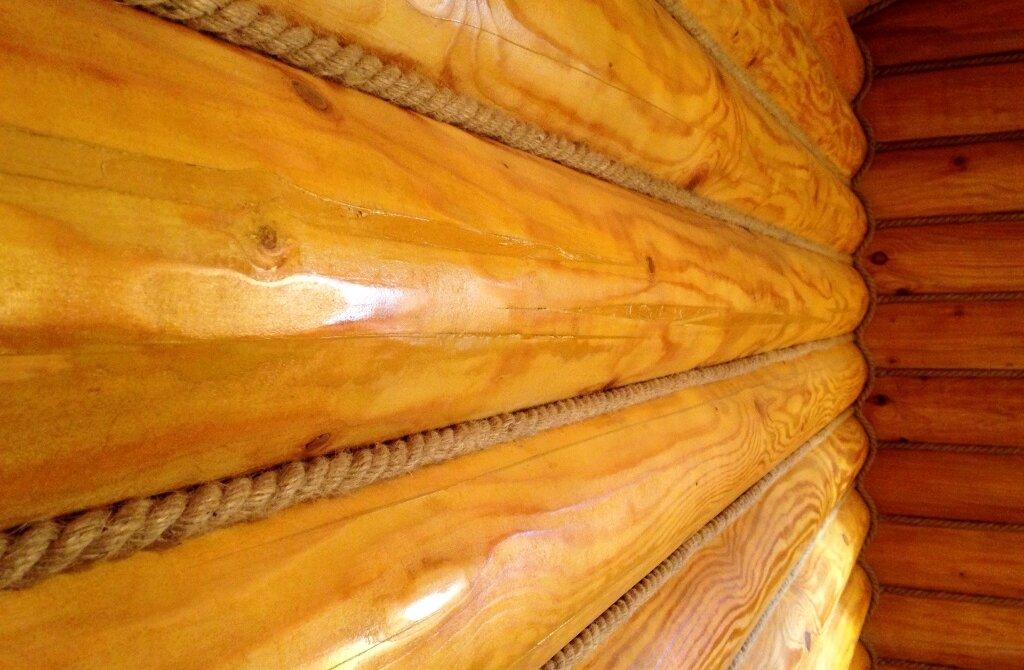 Крепление джутового каната между швами сруба